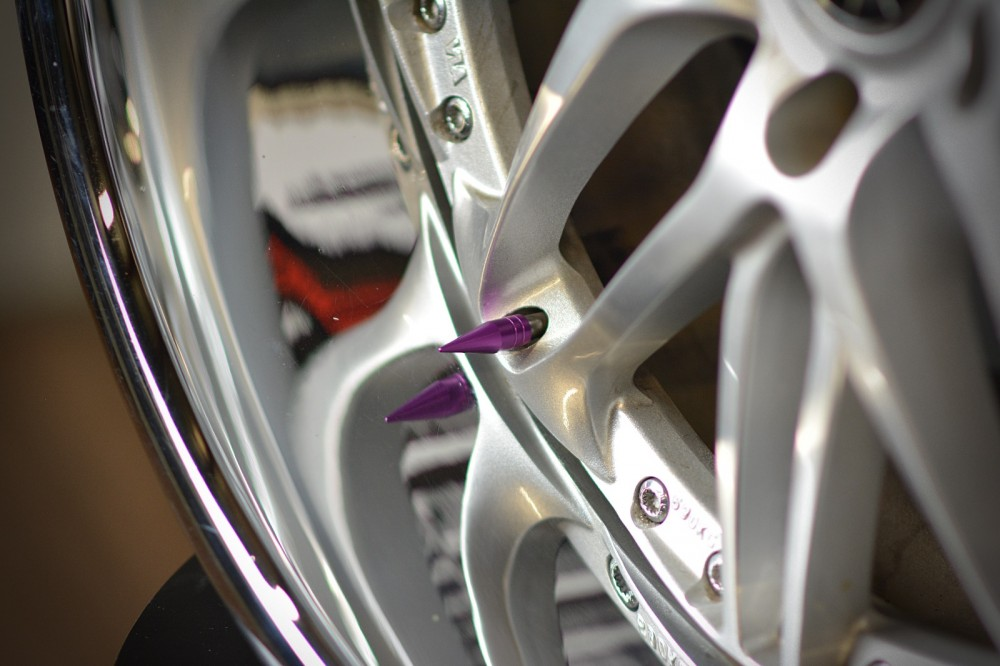 Color PURPLE 1.25in Spiked Metal Valve Stem Caps (4)